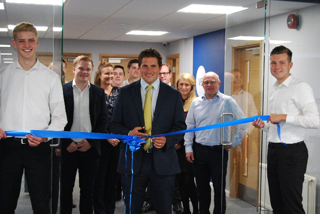 Johnny Mercer cutting ribbon to Ventro office